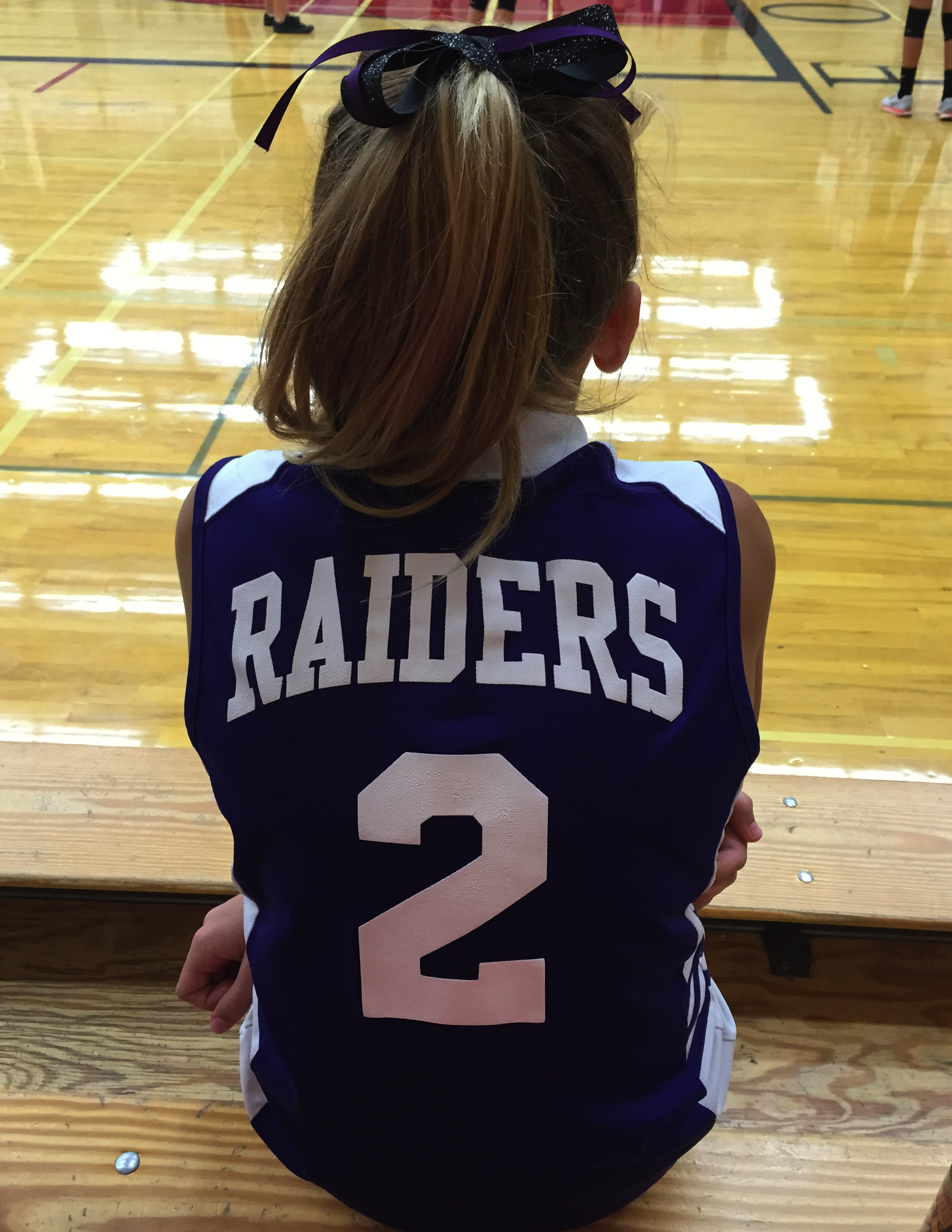 Girl in Raiders Uniform